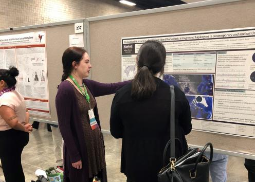 SACNAS Conference presenter discusses their research with conference attendee